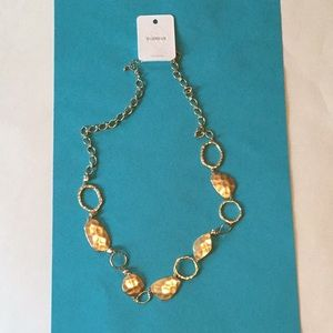 Chunky long gold tone necklace